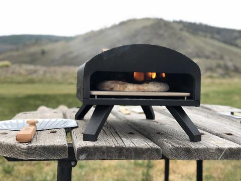 Bertello-Pizza-Oven-Cooking-Pizza-Sitting-on-Table